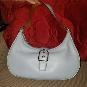 Coach leather bag with belted closure.